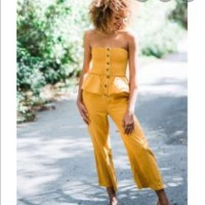 🌞Urban outfitters yellow ruffled jumpsuit NWT 🌻